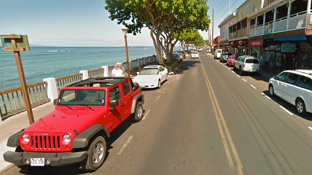 Red Jeep parked on Main Street Lahaina