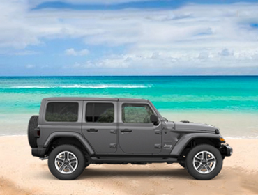 Wrangler Unlimited parked on beach for photo