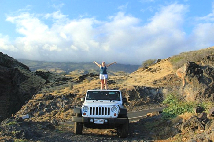 Person on top of a Maui Jeep rental